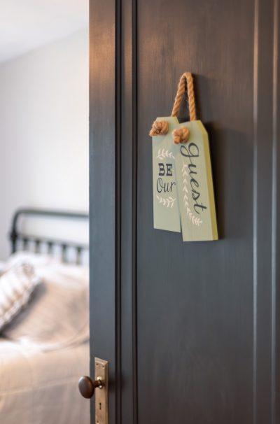 Open door of guest bedroom in old house (vertical)